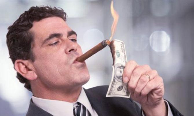 Banker burning money