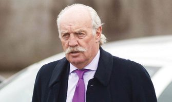 Dermot Desmond at Gerry Corr's funeral